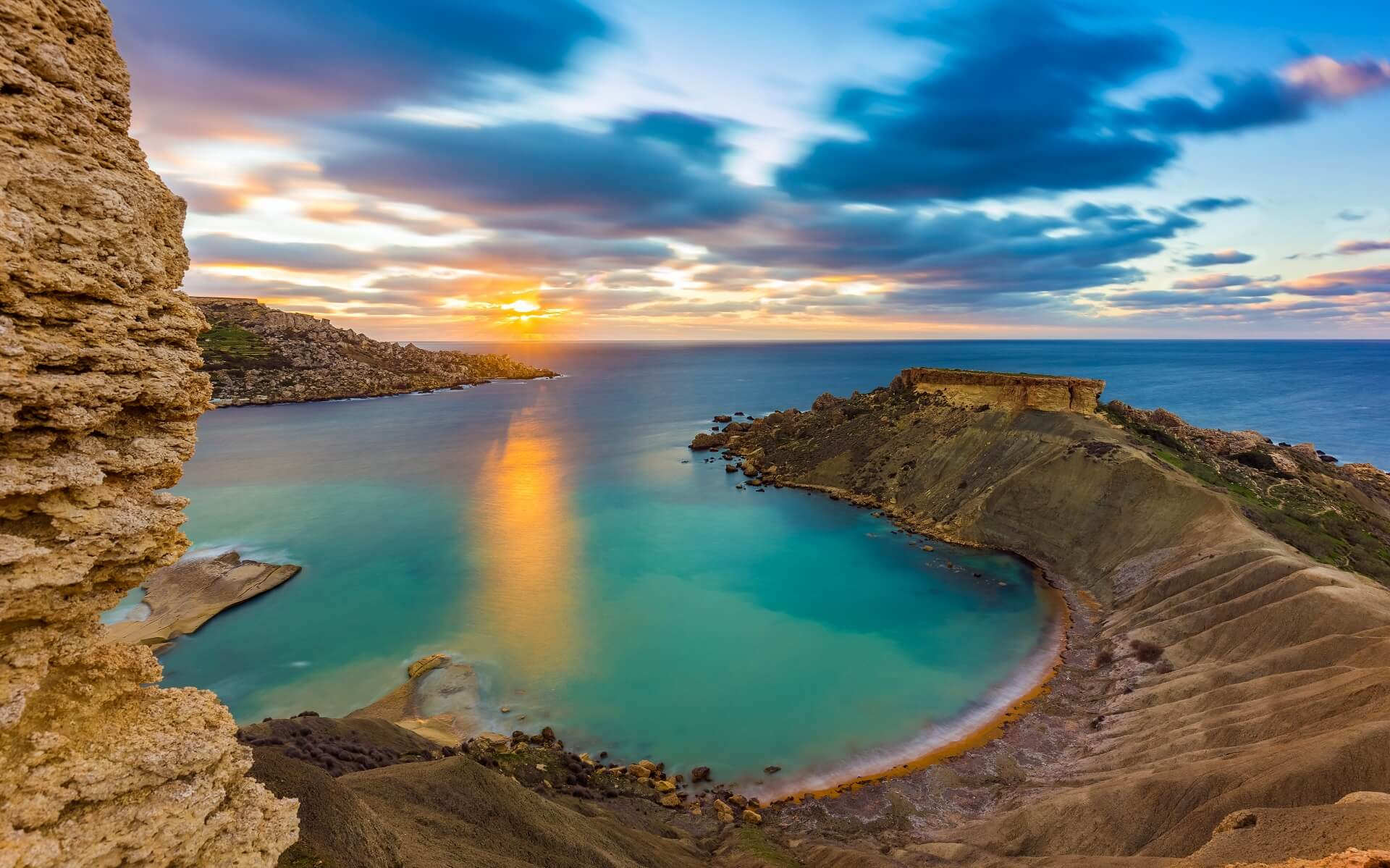 Mgarr Malta Panorama Of Gnejna Bay The Most Beautiful Beach In Malta At Sunset With Beautiful Colorful Sky And Golden Rocks Taken From Ta Lippija Shutterstock_662879173